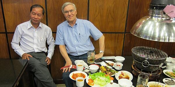 Dr Le Hau and Steve Robinson enjoying-dinner-in-Saigon