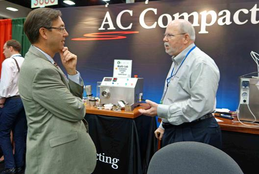 Dr Erik Santander from Scintinpharma Inc and Bob Fortier (AC-Compacting) discussing the new Caleva Multi Lab at the recent AAPS