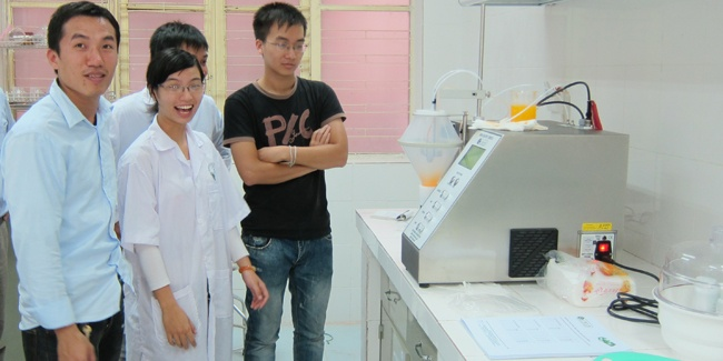 Students at the Hanoi School of Pharmacy enjoying their work with the MCD Mini Coater Drier